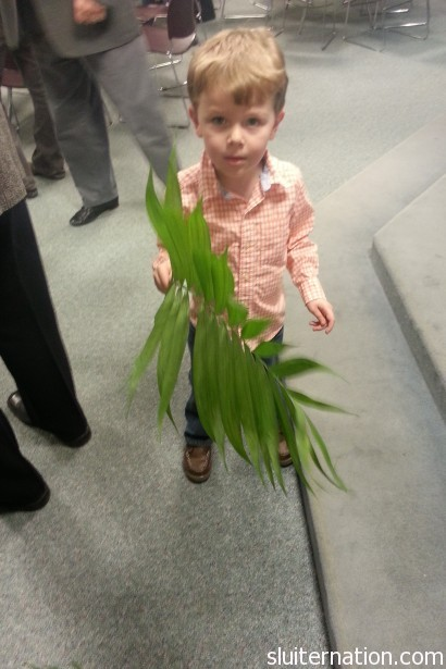 March 24: Palm Sunday...sing Hosanna!  Eddie was on Palm handout duty.