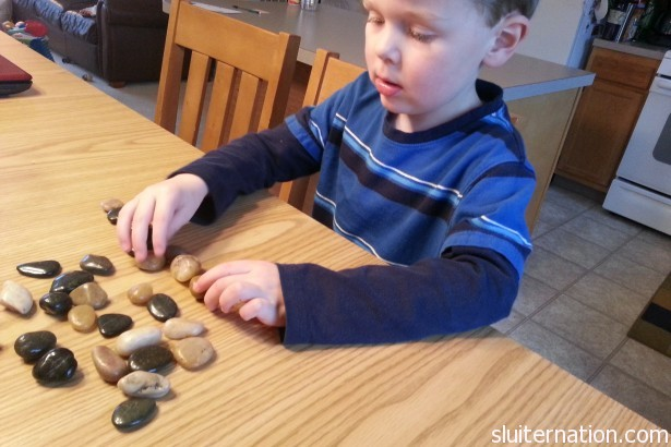 April 11: Eddie counts his Kindness Stones.  So close to filling that bucket and choosing a reward!