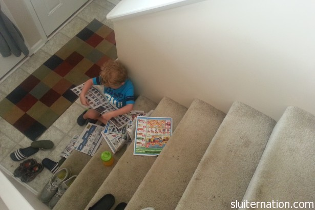 June 9: Reading the Sunday ads in the only place his brother can't bother him.