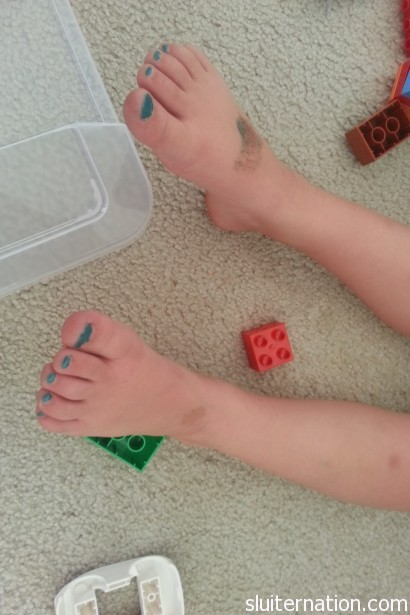July 5: Eddie asks for blue toes...to match his Aqua Man tattoo...while he plays Legos.