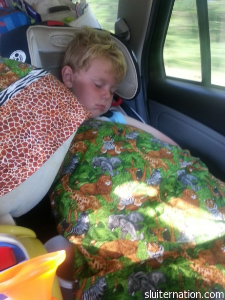 August 21: After a big morning playing by Lake Michigan, the long drive home from vacation knocked both boys out.