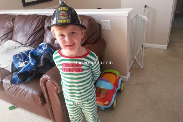 October 10: Day 3 of The Sickness. His bestie got him the souvenirs from the preschool visit from the  firemen. Eddie even smiles about it.