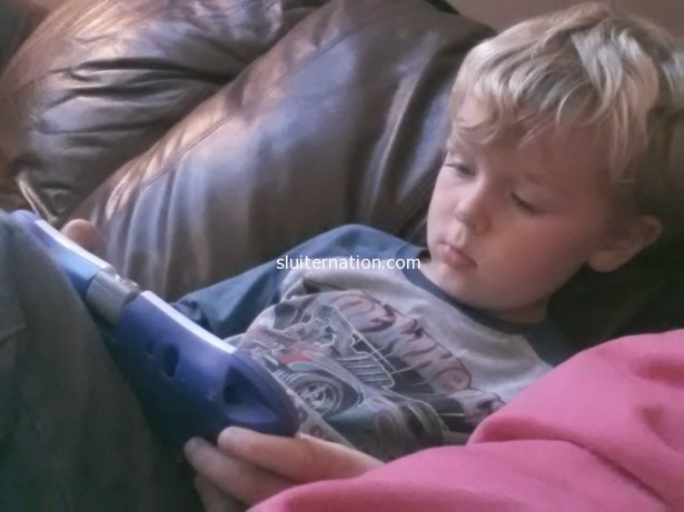 October 17: Science games on his tablet while mommy watches the news.