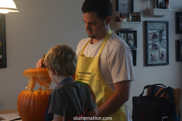 Time to carve. Cort explains the process to Eddie.