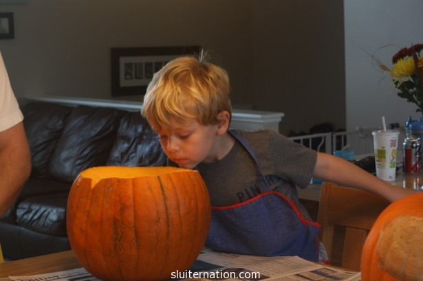 October 27: Pumpkin carving. He has never liked the guts...and this year is no different. Wouldn't touch 'em.