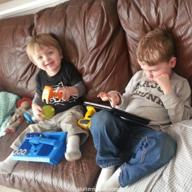 "Always after school: Eddie on the tablet and Charlie watching ""Krat Krats"" while I make dinner."