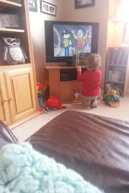 April 1: The small one opts to read...in the way of the TV watchers. Typical.
