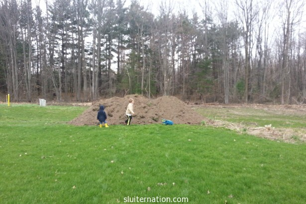 April 28: A big pile of dirt arrived. Heaven for our two dirt balls.