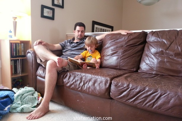 July 1: Just reading a book to daddy.