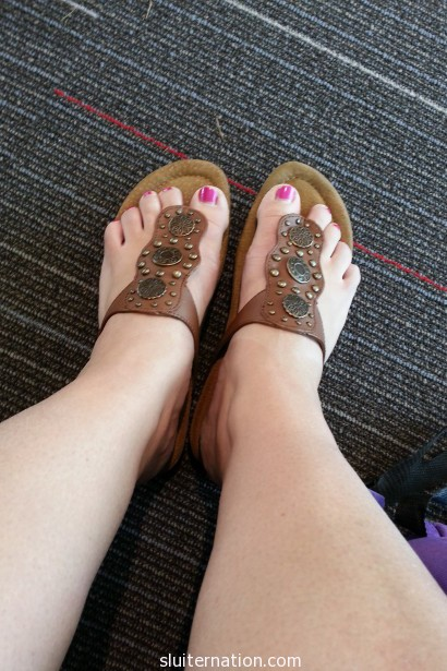 July 23: feet in an airport. I hate the travel part because it's a lot of crowds and waiting.