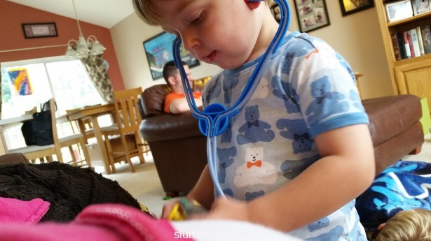 August 29: Charlie is sort of obsessed with his doctor kit lately. He listened to my ears, nose, mouth, and legs.