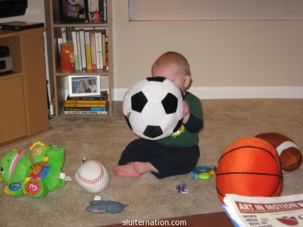 He always picked the soccer ball out of the pile.